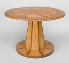Austrian Biedermeier (19th Cent) maple & mahogany center table with an octagonal solid pedestal resting on a round platform base supporting an inlaid 8 pointed star top