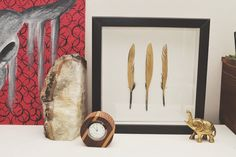 studs and pearls: home decor diy: Gilded Feather Wall Art