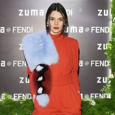 Kendall Jenner rocked a sizzling red romper that showed off her long legs with a multicolored shawl in Rome on March 10. Do you love the red carpet style or hate it?