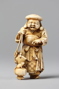 Daikokuten (Daikoku), god of wealth, commerce and trade. Ebisu and Daikoku are often paired and represented as carvings or masks on the walls of small retail shops