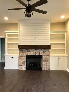 Shiplap over fireplace + symmetrical built-ins