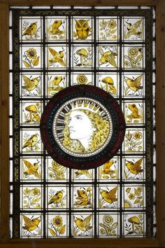 JOHN MOYR SMITH (ATTRIBUTED TO)  STAINED, PAINTED AND LEADED GLASS AESTHETIC MOVEMENT PANEL centered with a roundel depicting a Grecian goddess, within a field of square panels with bird, flower, insect, and amusing frog studies. Approximate panel size: 82.5cm x 52cm wide