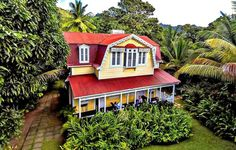 Tucked in the tropical rain forest of Soufrière on St. Lucia is the 250-year-old working plantation of Fond Doux. The 15 French Colonial fretwork cottages—some of which were moved from other island areas—were restored, then outfitted with four-posters and rocking chairs. A vacationer here can subsist on the verdant land's spoils, including fresh-plucked bananas, breadfruit, mango, guava, and . . . cocoa. Cocoa harvesting and rolling is done right on the plantation.