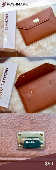 """Michael Kors 💻 Computer/iPad holder RARE. Michael Kors no longer sells it on their website. This is new with tags and has never been used. It's ok perfect condition. Fits the Mac Book Air 11"""" and any sizes iPad! Absolutely beautiful with genuine leather. 💻 Michael Kors Accessories Laptop Cases"""