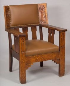 Shop of the Crafters, attribution, oak armchair, early 20th century.  Wing back with two medieval influenced figures carved on wings, flat arms over cut-out side panels, ht. 38 1/2 in.