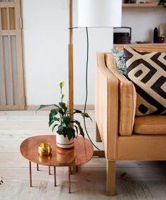 I am in love with this copper side table. The white wooden flooring. The tan sofa. The wooden shelves. Estilo Interior, Home Interior, Interior Styling, Interior Modern, Home Living Room, Living Room Decor, Living Spaces, Home Design, Copper Side Table