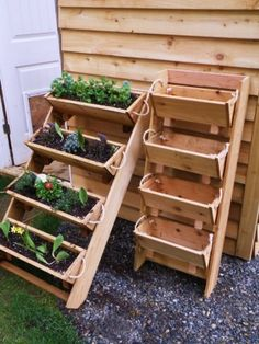 veggie planter idea - great for temporary locations (renting or not sure you want to dig up the yard?); and clean it out and use the bins inside for hats and gloves storage during winter months!