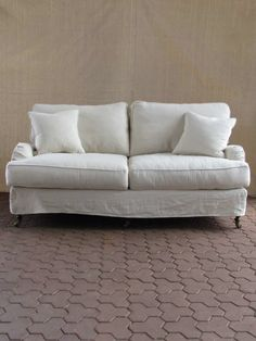 A classic that works in any living space.  Gorgeous slip-covered sofa from redinfred