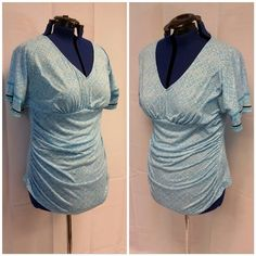 """SALE! Blue white rusched sides high low top XL Blue white, rusched sides, high low hem, V-neck, full bat/doleman fluttery sleeves, single black band towards end of sleeves, shirt tail hem in front, straight hem in back. Goes great with blue pencil skirt. 33"""" shoulder to hem in front, 22"""" from shoulder to hem in back, 41"""" bust, 38"""" arm pit seam to arm pit seam, 5"""" V-neck, 36"""" (approx due to rusching) waist from side seam to side seam, 21 1/2"""" from seam under bust to front hem. New York…"""