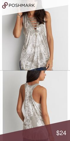 NWT AEO Soft &a Sexy Ladder Front Tank in XL NWT AEO Soft & Sexy Grey Splattered Ladder Front Tank Top in XL. Made in a super-soft jersey material. Materials 95% Viscose and 5% Elastane. Brand New, Never Worn!  🚫Trades/Holds🚫 🚫Will NOT accept lowball offers!🚫 📦Ships same day if PO is open📦 American Eagle Outfitters Tops Tank Tops