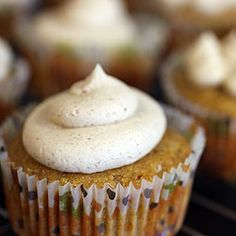 Pumpkin cupcakes with cinnamon brown sugar buttercream... Top with Halloween candy for a sweet and festive treat!