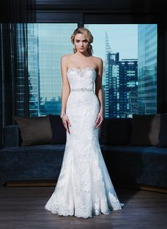Justin Alexander signature wedding dresses style 9720 A luxurious beaded sweetheart neckline and beaded trim at the natural  waistline accent this layered lace fit and flare. Satin and beaded  buttons cover the back zipper and continue to the end of the chapel  length train.