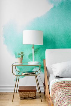 """The brass-and-glass <a href=""""http://westelm.7eer.net/c/343160/277866/4336?aadid=1418602&u=http%3A%2F%2Fwww.westelm.com%2Fproducts%2F1418602%2F%3FcatalogId%3D71%26sku%3D1418602"""">nightstands</a> only up the luxury factor."""