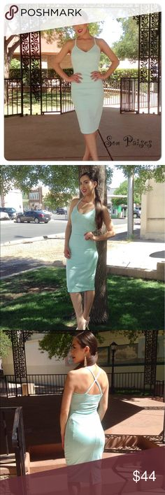 Mint Green Dress New Listing-4/23/17: This gorgeous body con dress features cross cross back accent. Beautiful embossed stretch material and lined. 100% Polyester. Summer perfection! (This closet does not trade) Boutique Dresses Midi