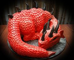 My Red Dragon Cake - This is my second sculpted dragon cake. I made this for my brother Donnie. It is all chocolate fudge cake with chocolate ganache filling (head and tail too). Scales, horns, and spikes are made from fondant and modeling chocolate. Dragon Birthday Cakes, Dragon Cakes, Birthday Pies, 10 Birthday, Chocolate Ganache Filling, Chocolate Fudge Cake, Crazy Cakes, Fancy Cakes, Pink Cakes
