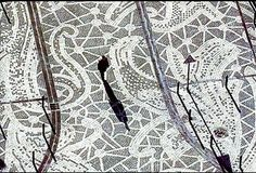 Pont-Audemer in Normandy, France had been known for their lace production.  Artist Elisabeth Ballet designed this Lace pavement.