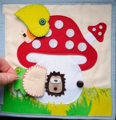 very cute quiet book page with a mushroom house and little flaps. I love the snail hiding under the leaf :) Diy Quiet Books, Baby Quiet Book, Felt Quiet Books, Felt Crafts, Diy And Crafts, Silent Book, Diy Y Manualidades, Quiet Book Patterns, Felt Patterns