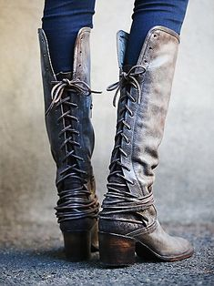 Coal Tall Boot   Washed leather tall boots, featuring tonal suede backs with leather lacing that wraps multiple times around the ankle and laces up to topline. Partial side zips and wooden block heels. *By Freebird by Steven