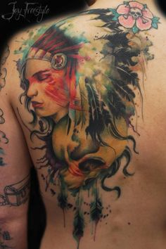 Watercolor/realistic style female Native American chief tattoo on the left upper…