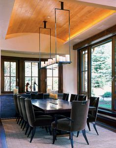I love the mix of textures in this dining room. From the warm, wooden barrel-vaulted ceiling to the chairs upholstered in chocolate-brown velvet, it all just works.""