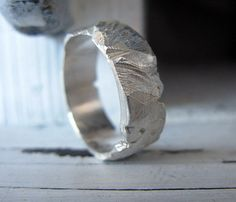 The wedding band I got for my fiancé :) Mens Wedding Band Distress Silver Ring Rustic Band Hot Rox on Etsy, $145.00