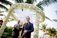 Flowers dress up a classic beach setting for a beautiful wedding ceremony. #HoiAnEventsWeddings #HoiAn #VietnamBeachWeddings