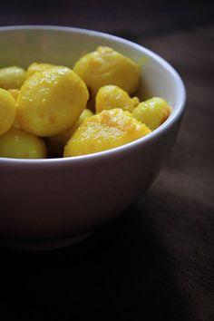 Potatoes in mustard oil, salt and turmeric for 'Dum Aloo'