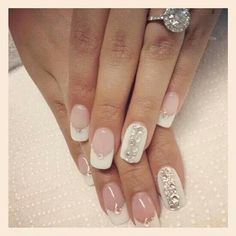 French manicure jazzed up with diamanté detail