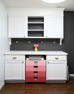 The grey really makes the white pop! Great space to keep organized, but still has a lovely splash of color with the ombre drawers (Studio Progress: Major Cabinet Upgrades!)