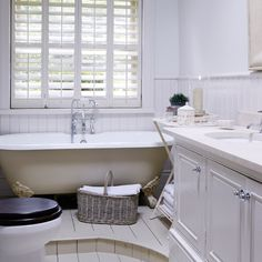 All-white bathroom with roll-top bath and shutters | Bathroom decorating | Country Homes & Interiors | Housetohome.co.uk