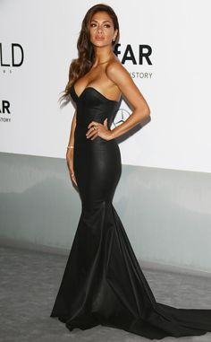 Nicole Scherzinger looks flawless in a body-hugging black strapless gown.