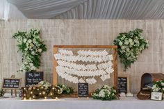 Hanging escort cards and chalk board signage. Gift table ideas.