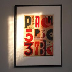 Beautiful evening sun still streaming into our lounge and highlighting the rich reds in this picture. #summerevening #sunlight #easternbloc #redandblack #russian #sovietart #russianposter #russiantype #bauhaus  #geometricart #limitededitionprint #etsyshop #etsysellersofinstagram #affordableart #foundart #interiorstyling #industrialvintage #typographyart #vintagenumber #vintageletters #artdeco #interiorinspo #redtones #texture #juliatrigg