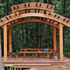 A curved roofline can have a dramatic effect. This freestanding pergola fuses Asian and contemporary styles with its clean lines and spare detailing. Although the structure looks simple, the two-tiered roof requires highly-skilled professional expertise to produce the large curved laminated beams./