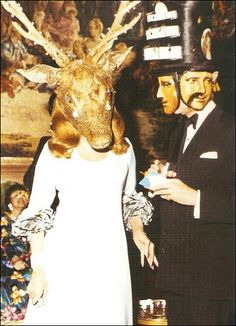 "Photos from a 1972 Rothschild illuminati party  On 12/12/72 Marie-Hélène de Rothschild, member of the most powerful elite family in the world, held a Surrealist Ball at Château de Ferrières, one of the family's gigantic mansions.  The invitation was written in reverse. It required a mirror to be read. Inversion is a big deal in a pseudo-satanic mind state.  Guy de Rothschild & Marie-Hélène de Rothschild, the hosts of the ball, wore a horned ""giant's head"" with tears made from real diamonds."