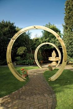 Grange Flower Circle - A stunning free standing circular walkway structure that will create a fantastic feature in any garden. Each flower circle is composed of two timber circles closely connected with stainless steel rods to create a sculptural archway Diy Pergola, Wooden Pergola, Pergola Ideas, Cheap Pergola, White Pergola, Pergola Roof, Pergola Plans, Gazebo, Garden Arches For Sale
