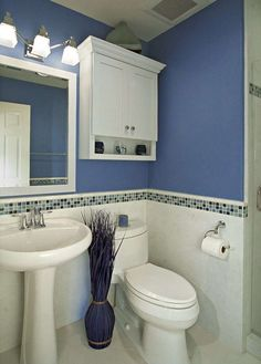 Decorate small bathroom cheap tiny bathroom with theme designed in white and blue colors with blue vase small apartment bathroom decorating ideas on a Blue Bathrooms Designs, Bathroom Design Small, Bathroom Colors, Bathroom Ideas, Small Bathrooms, Tiled Bathrooms, Bathrooms Decor, Decorating Bathrooms, Bathroom Gallery