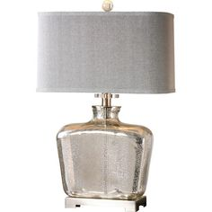 Cast a warm glow in the office or library with this stylish table lamp, featuring a mercury glass base and tapered hardback shade. P...