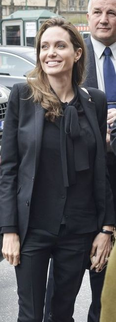 Who made Angelina Jolie's black blazer and bow top? Jacket and shirt – Saint Laurent
