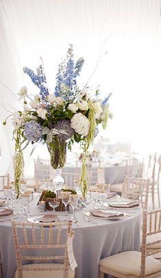 Centerpiece incorporating blue hydrangeas and succulents