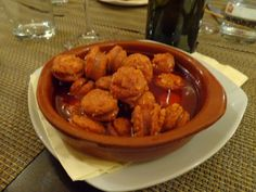 Spanish paprica sausage in white wine sauce @ Restaurant LOLA - Spanish Tapas