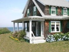 Anything About Inspirational Cape Cod House, Take a Look ! Cape Cod House Plans interior and exterior look Pilasters at the corners and sidelights at the door are embellishments on the Cape Cod style. Explore our Gallery of Cape Cod homes. Cape Cod Cottage, Maine Cottage, Beach Cottage Style, Beach Cottage Decor, Coastal Cottage, Coastal Homes, Cottage Homes, Coastal Living, Cozy Cottage