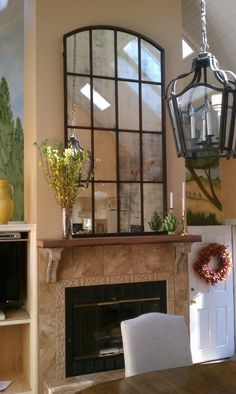 windowpane mirror.  Look how dwarf the door looks next to the fireplace!!