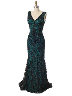 <p>We can envision Marilyn in a curve enhancing evening gown such as this. For vintage inspired starlet flair at your next special event, consider this figure hugging beauty in teal jersey overlaid by black stretch lace. Red lipstick, black opera length gloves and glittery rhinestone jewelry are a must to complete your classic Hollywood bombshell look.</p> <p>DETAILS<br />•V neckline edged in scalloped black lace.<br />•Center seam with ruching then flaring to a trumpet skirt creat...