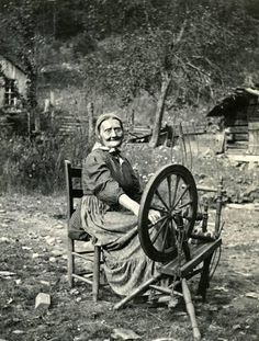 "Sally Creech, more affectionately known as ""Aunt Sal"" spinning wool at her wheel. For Aunt Sal, spinning and weaving was an artistic & meditative endeavor & she often found solace  while losing herself in her labors. Her relaxed smile expresses that this was a time for her to sit & contemplate while practicing her favorite skill. According to her children, whenever she was weaving, ""we'd have to go naked…for all the notice she'd take of us, & we'd eat all the peach pie we wanted, for dinner...."