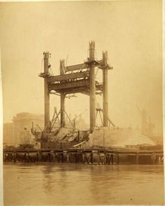 Never before seen photographs of the construction of Tower Bridge being constructed have been unveiled after a stash of hundred-year-old photos were found in a skip.
