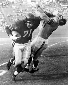 Chicago Bears linebacker George Connor stiff arming a Los Angeles Rams player (1950)