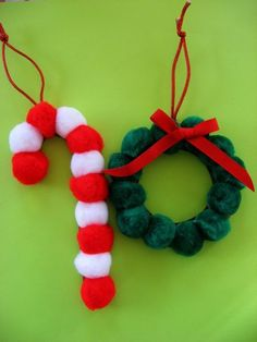 Pompom Ornaments!  So easy the kids could help make these! Also some cute & easy rolled-paper candy canes.