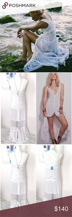 Free People White Lace Maxi Dress NWT Gorgeous free people button front white Maxi dress with lace. Semi Sheer fabric. Can be worn as a duster too. Delicate, feminine and beautiful. Free spirit, boho goddess dress Free People Dresses