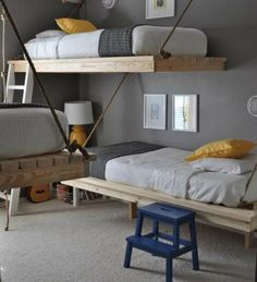 rope suspended platform beds. 3 in one room! this is so cool